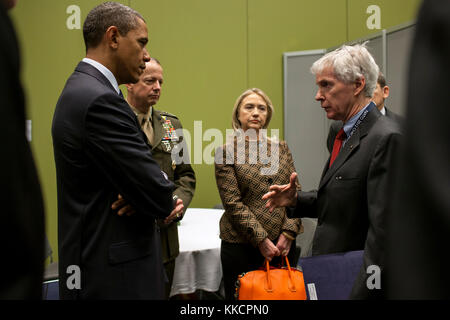 President Barack Obama talks with Ryan Crocker, U.S. Ambassador to Afghanistan, before a bilateral meeting with - Stock Photo