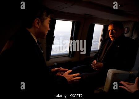 President Barack Obama talks with Sung Kim, U.S. Ambassador to Republic of Korea, aboard Marine One during an early - Stock Photo