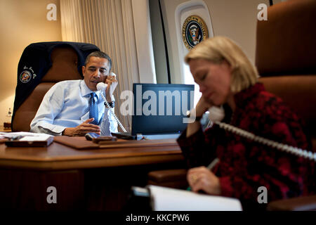 President Barack Obama talks on the phone with President-elect Vladimir Putin of Russia while aboard Air Force One - Stock Photo