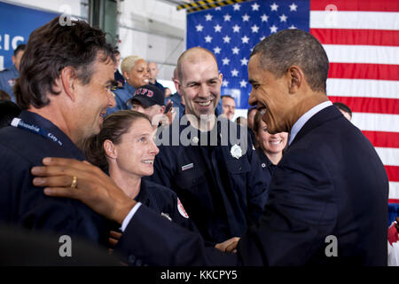President Barack Obama greets members of the audience following his remarks on the Veterans Job Corps at Fire Station - Stock Photo