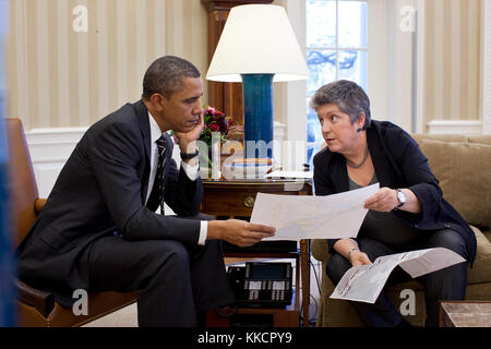 President Barack Obama meets with Homeland Security Secretary Janet Napolitano in the Oval Office, Jan. 31, 2012. - Stock Photo