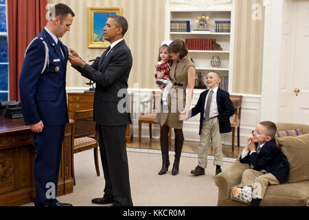 Members of the Price family watch as President Barack Obama presents Defense Superior Service Medal to departing - Stock Photo