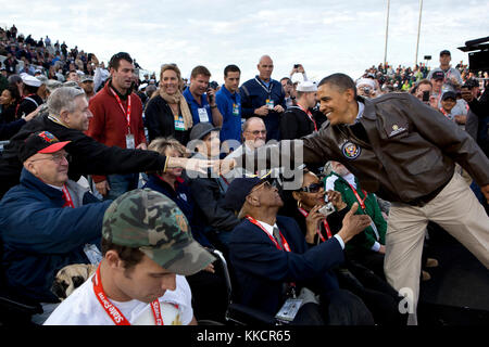 President Barack Obama greets veterans before the Carrier Classic basketball game between the University of North - Stock Photo