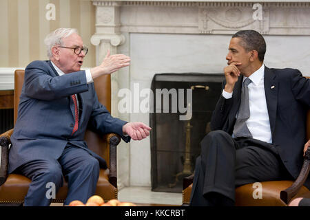 President Barack Obama meets with Warren Buffett, the Chairman of Berkshire Hathaway, in the Oval Office, July 18, - Stock Photo