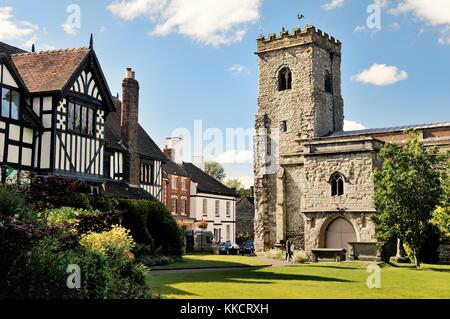 Holy Trinity Parish Church in the village of Much Wenlock, Shropshire, England. 16 C half-timbered Guildhall on - Stock Photo
