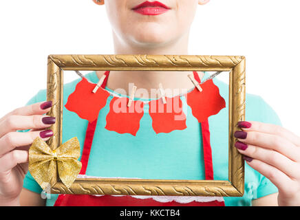 Woman holding photo frame with hanging blank papers with copy text space as Christmas wish and love concept - Stock Photo