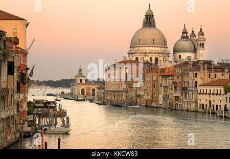 The church of Santa Maria della Salute at dusk viewed from the bridge over the Grand Canal at Academia in the city - Stock Photo