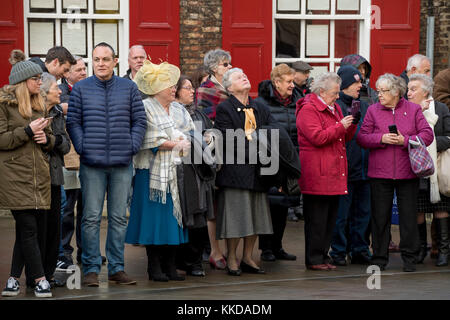 Close-up of people lining the route standing at side of road in the cold, before military parade outside York Minster - Stock Photo