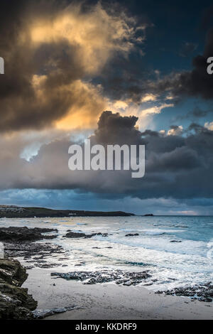 UK weather -as the sun sets ominous heavy rain clouds build over East Pentire Headland on the North Cornwall coast
