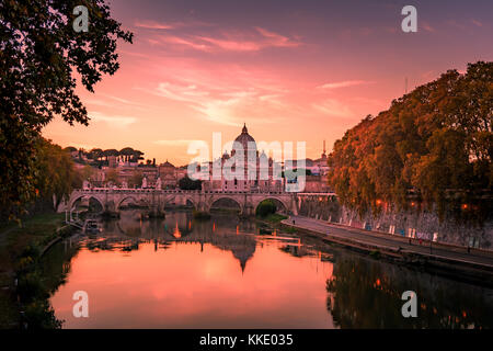 Beautiful view over St. Peter's Basilica in Vatican from Rome, Italy during the sunset in Autumn - Stock Photo