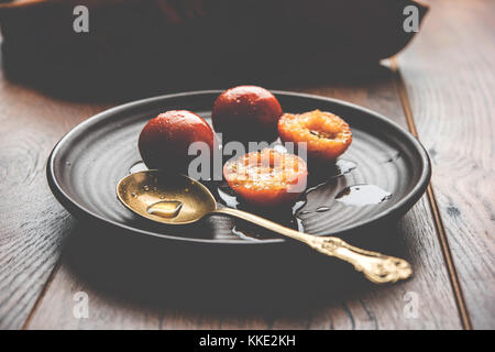 Gulab jamun /gulaab jamun is a milk-solid-based Indian sweet made in festival or wedding party - Stock Photo