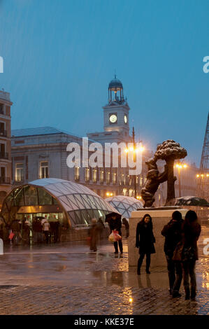 Snow covered Puerta del Sol, night view. Madrid, Spain. - Stock Photo