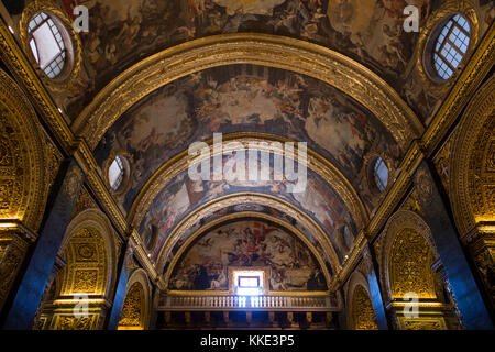 Baroque & highly decorated vaulted ceiling depicting life of St. John, painted by Mattia Preti, interior inside - Stock Photo