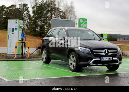 SALO, FINLAND - NOVEMBER 18, 2017: New, black Mercedes-Benz GLE hybrid SUV charges battery on electric vehicle charging - Stock Photo