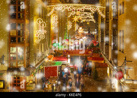 Christmas street at night in Dresden, Germany - Stock Photo
