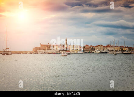 Sun braking through the clouds on stormy day in Budva, Montenegro. - Stock Photo