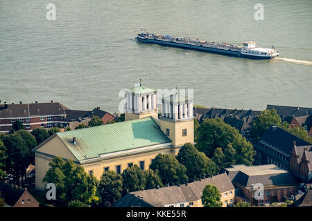 Church of St. Assumption with cargo ship on the Rhine at Rees, Rees, Lower Rhine, Rhein, North Rhine-Westphalia, - Stock Photo