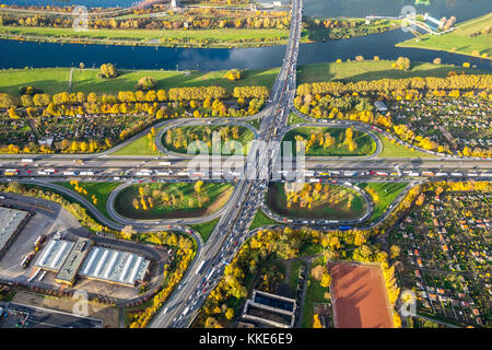 Autobahnkreuz Kleeblatt, A40 and A59 to rushhour, traffic jams on the A40 near Duisburg, allotment gardens, allotment - Stock Photo