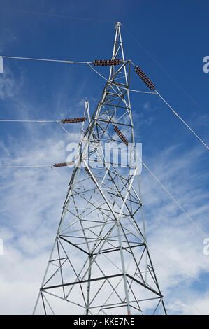 metal electric high power line tower with sky background - Stock Photo