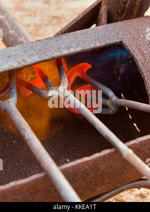 Irons Glow Red Hot in Preparation for Branding Cattle on a Texas Ranch - Stock Photo