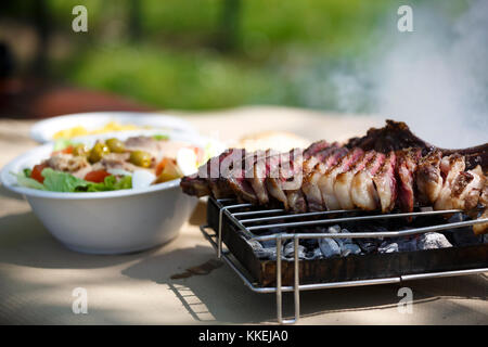 Steak with salad and fries. - Stock Photo