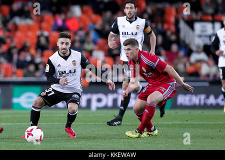 Nacho Gil of Valencia CF   (L) in action against Grippo of Real Zaragoza  during spanish the Copa del Rey, Round - Stock Photo