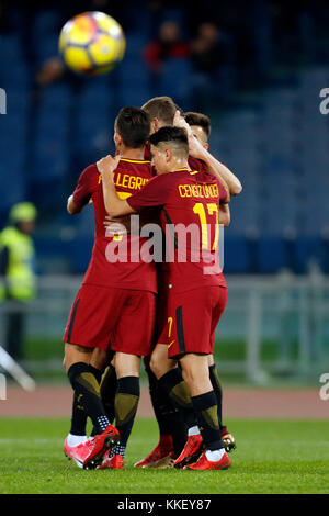 Olympic Stadium, ROME, Italy. 01st Dec, 2017. Edin Dzeko (C) of Roma celebrates with teammates after scoring during - Stock Photo