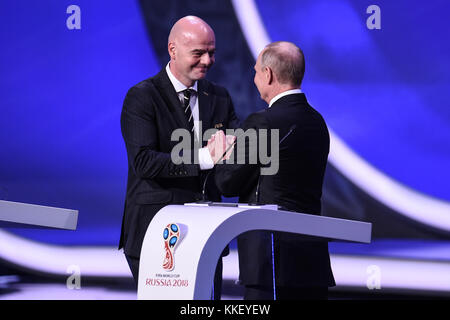 Moscow, Russia. 1st Dec, 2017. FIFA President Gianni Infantino (L) and Russian President Vladimir Putin shakes hands - Stock Photo
