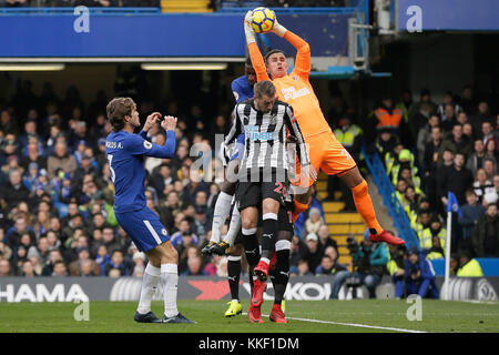 London, UK. 2nd Dec, 2017. Newcastle's goalkeeper Karl Darlow (1st R)saves the ball as Newcastle's Florian Lejeune - Stock Photo