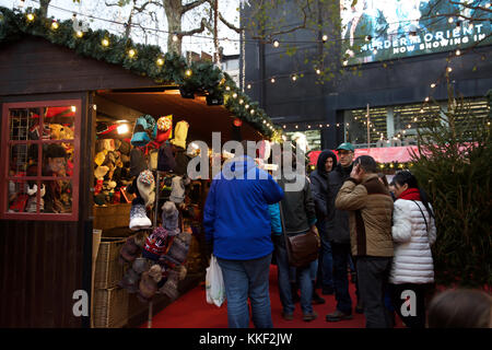 London, UK. 3rd Dec, 2017. People visit the Christmas Market in Leicester Square despite the dull and dismal weather - Stock Photo