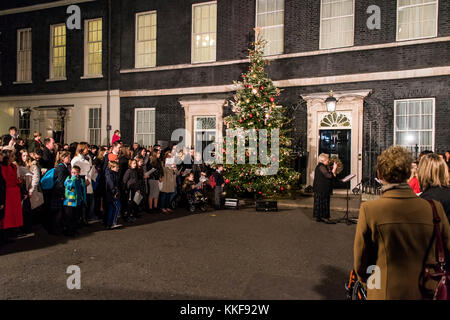 London, UK . 06th Dec, 2017. The Downing Street Christmas tree lights are switched on serenaded by a traditional - Stock Photo