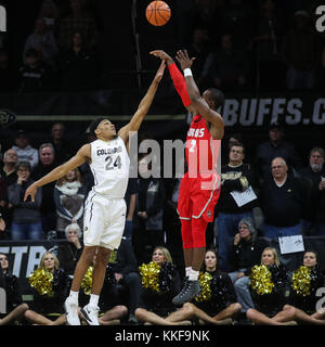 December 06, 2017: New Mexico's Sam Logwood puts up a shot over Colorado's George King in the first half at the - Stock Photo