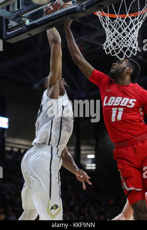 December 06, 2017: New Mexico's Jachai Simmons blocks the shot of Colorado's Dallas Walton in the first half at - Stock Photo