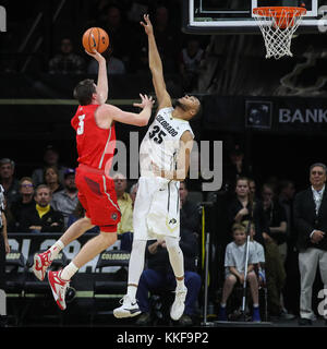 December 06, 2017: New Mexico's Joe Furstinger puts up a shot over Colorado's Dallas Walton in the first half at - Stock Photo