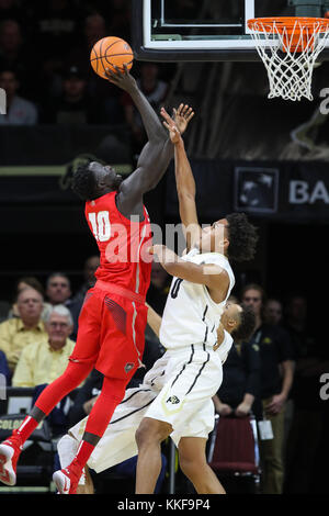 December 06, 2017: New Mexico's Makach Maluach puts up a shot over Colorado's D'Shawn Schwartz in the first half - Stock Photo