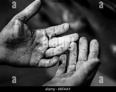side view of the both palms of a male. Black and white photograph of both palms covered in chalk. wrinkled palms - Stock Photo