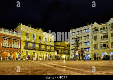 typical colorful facades with balconys of houses at Plaza de Los Coches, Cartagena de Indias, Colombia, South America - Stock Photo