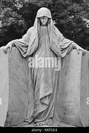 The shrouded lady of Hollywood Cemetery watches over a family crypt. - Stock Photo