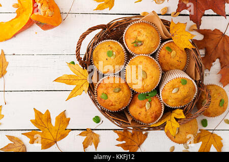 Appetizing and ruddy muffins with pumpkin and walnut. Flay lay. Top view - Stock Photo
