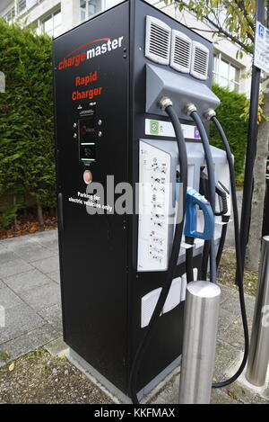 A Charge Master charging point for electric vehicles, Milton Keynes, England. Playing a key role in the delivery - Stock Photo