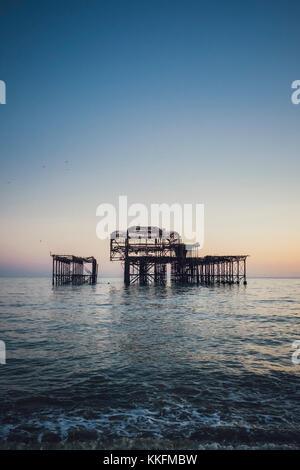 Burnt West Pier at dusk, Brighton, England - Stock Photo