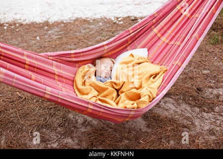 Little boy sleeping in a hammock - Stock Photo