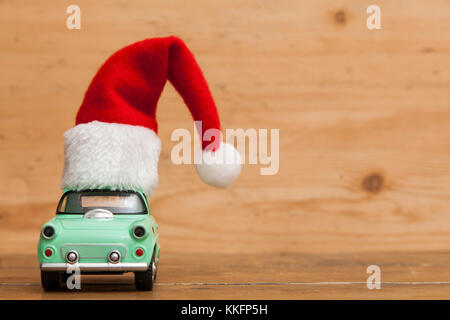 LONDON, UK - DECEMBER 30th 2016: Christmas background concept. Toy car with a Santa hat - Stock Photo
