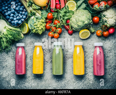 Variety  of colorful Smoothies or juices bottles beverages drinks with various fresh ingredients: fruits ,berries - Stock Photo