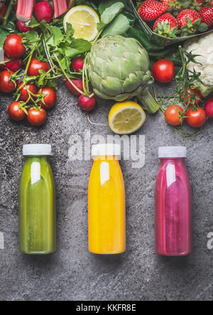 Variety of colorful Smoothies or juices beverages drinks in bottles with fresh ingredients: fruits ,berries  and - Stock Photo