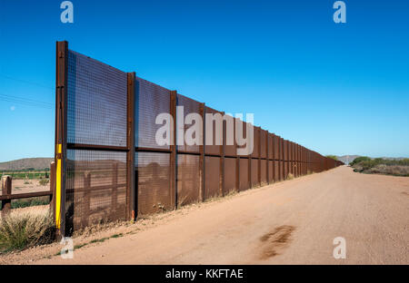 Fence at Mexican border, Sonoran Desert, Organ Pipe Cactus National Monument, Arizona, USA - Stock Photo