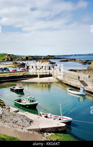 Ballintoy Harbour at White Park Bay between Bushmills and Ballycastle on County Antrim coast road, Northern Ireland.