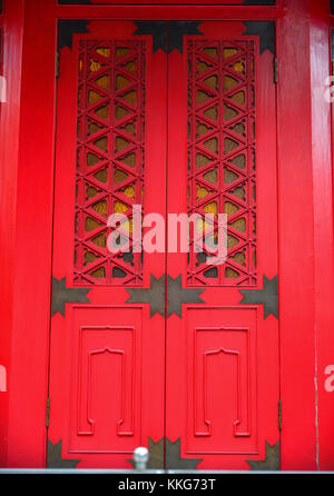 Red wooden door of ancient Buddhist pagoda in Hong Kong. - Stock Photo & Wall with red window doors at Buddhist temple Wat Mahatat Bangkok ...