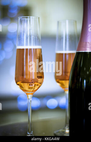 Two filled glasses and a bottle - Stock Photo