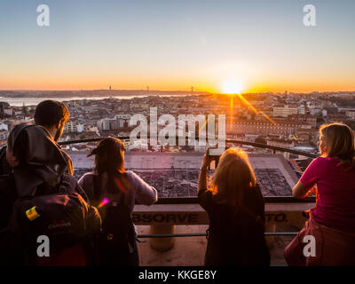 LISBON, PORTUGAL - NOVEMBER 19, 2017: Tourists at Belvedere of Our Lady of the Hill viewpoint, looking at the cityscape - Stock Photo